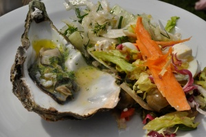 Garlic butter oyster with salad